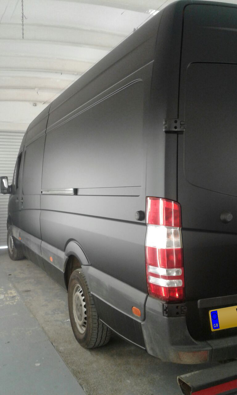 Yellow DHL Sprinter Van wrapped in Matt Black